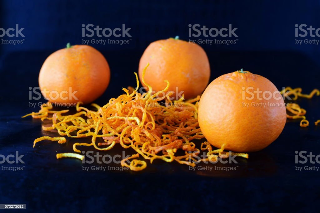 Fresh mandari zest with full fruits on a dark blue abstract background. Selective focus. stock photo