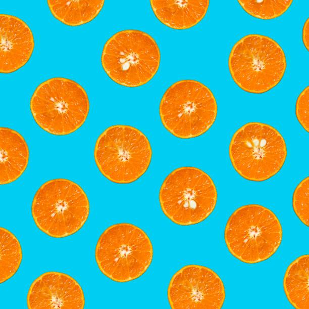 fresh mandarin pattern on bright background - поп арт стоковые фото и изображения