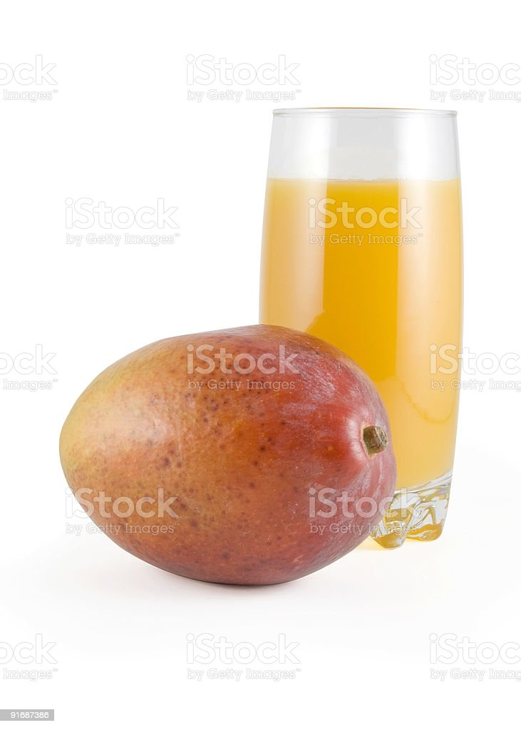 Fresh mango and glass of juice royalty-free stock photo