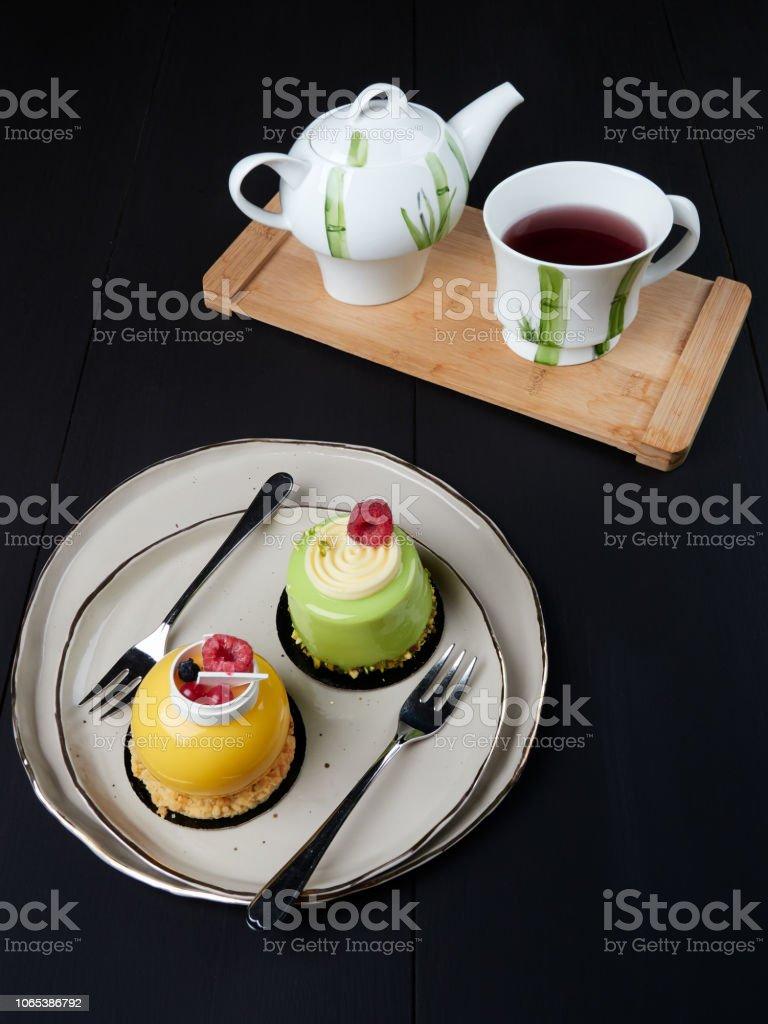 Fresh mango and pistachio cakes stock photo