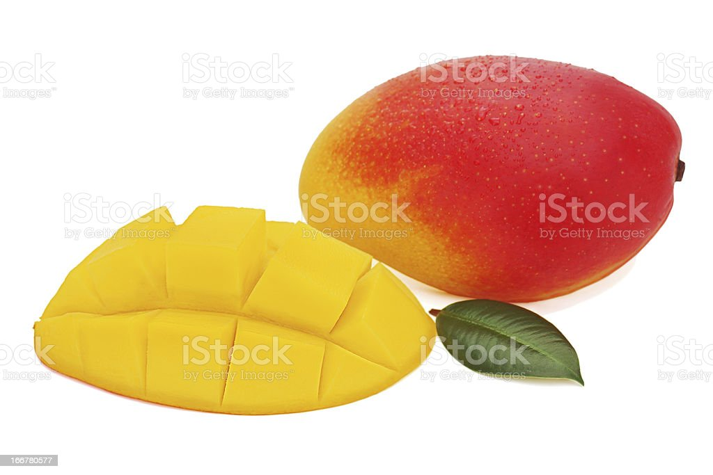 Fresh mango fruit with cut and green leaves isolated royalty-free stock photo