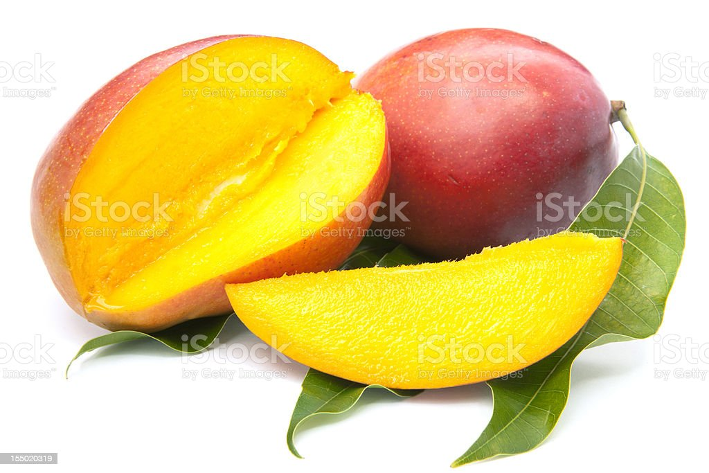 fresh mango fruit with cut and real leafs stock photo