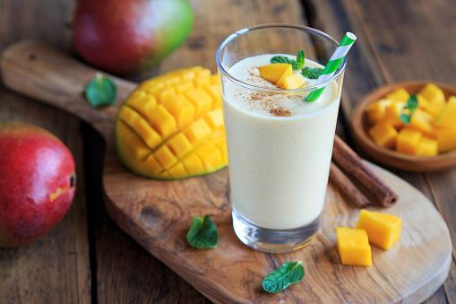 fresh mango lassi and mango fruit