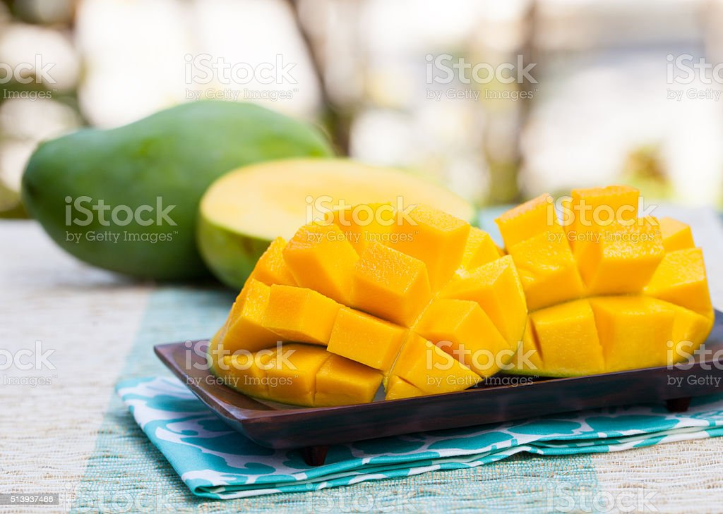 Fresh mango organic product on a tropical outdoor background stock photo