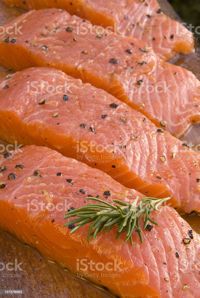 Fresh Marinated Salmon Fish Fillet; Seafood Cooking on Alder Plank royalty-free stock photo
