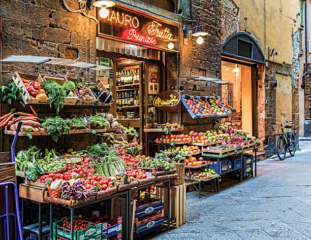 Fresh Market in Florence Italy Florence, Italy - March 10, 2014: Fruit and vegetables are displayed outside the small grocer, Mauro Tratta in Florence, Italy. Every morning the fruit and vegetables are placed outside for shoppers. florence italy stock pictures, royalty-free photos & images