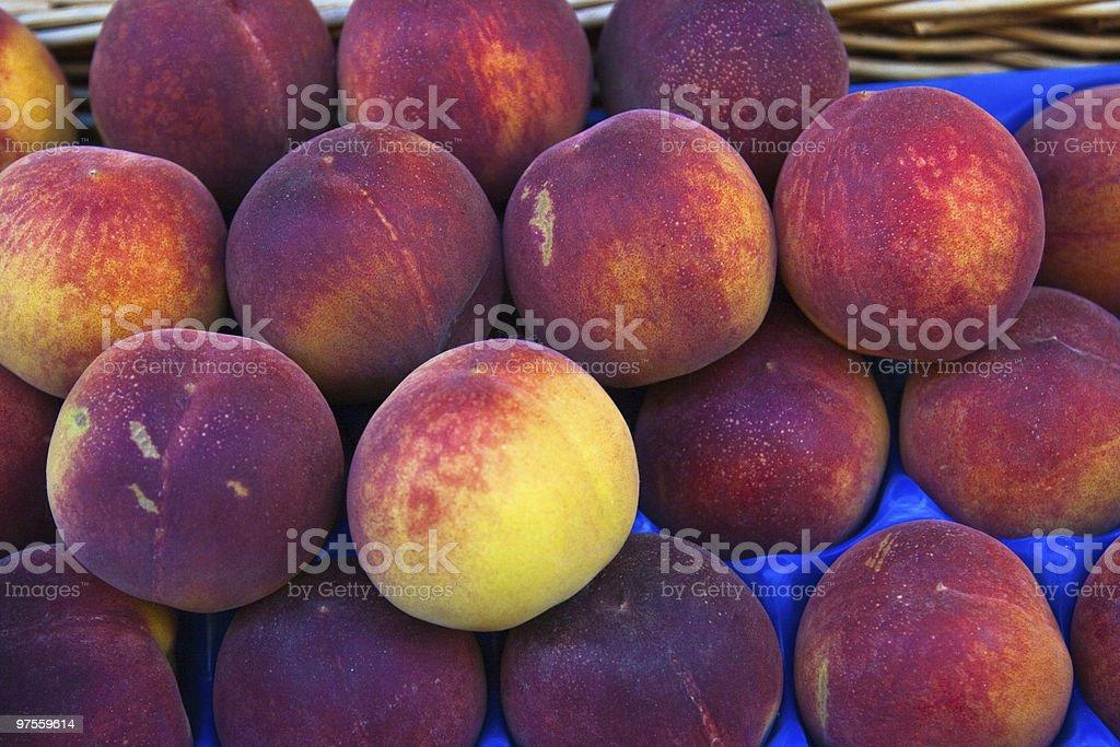 Fresh market peaches Paris royalty-free stock photo