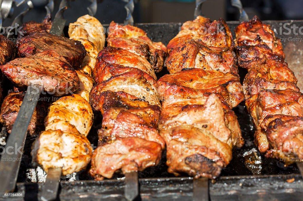 Fresh meat on a steel skewer stock photo