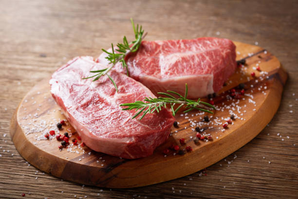 fresh meat with rosemary and spices stock photo