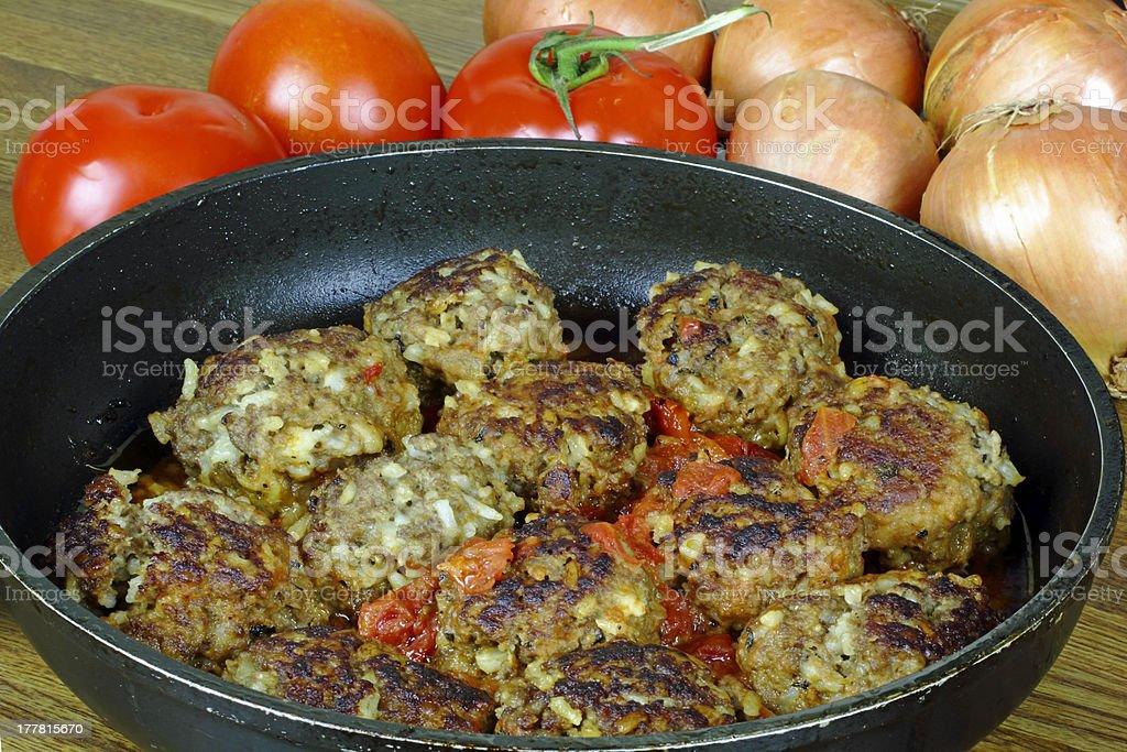 fresh meatballs burger on the frying pan royalty-free stock photo