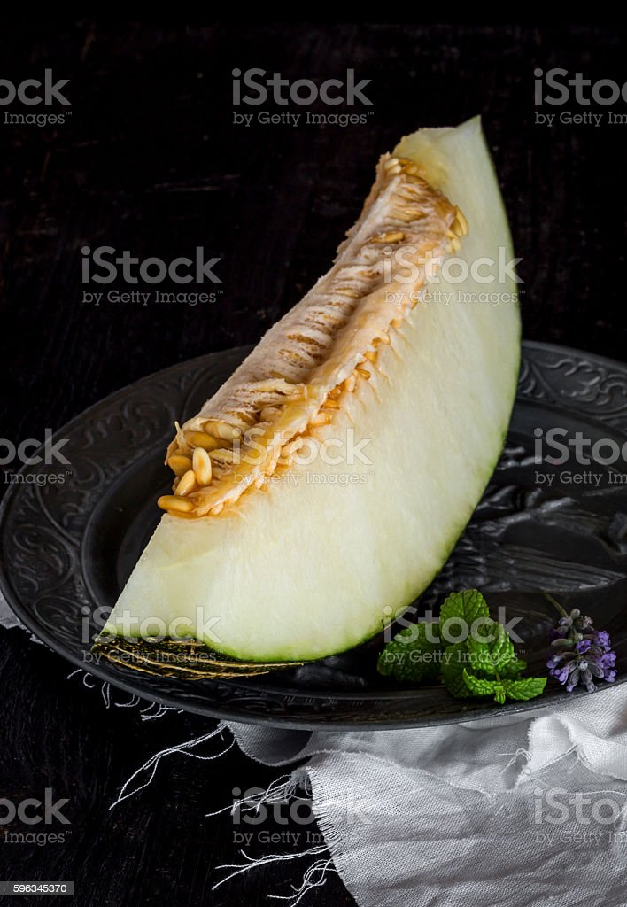 Fresh melon on the wooden table, selective focus royalty-free stock photo