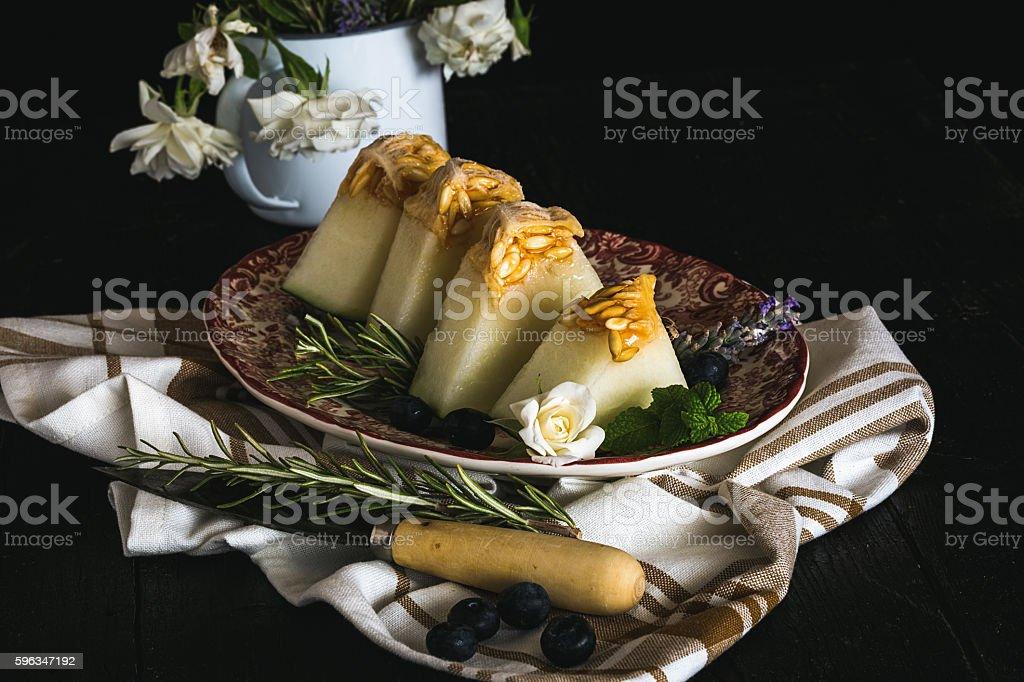 Fresh melon on the wooden table, selective focus Lizenzfreies stock-foto