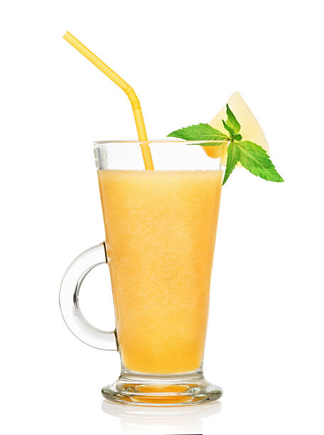 fresh melon smoothie in a glass isolated stock photo