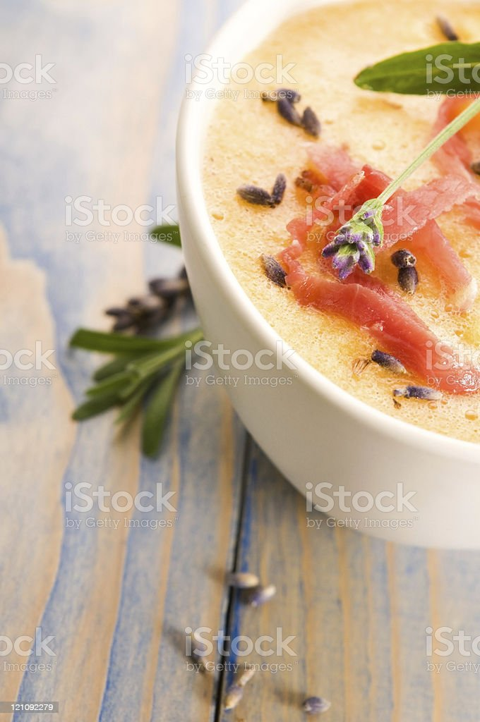 fresh melon soup with parma ham and lavender flower royalty-free stock photo