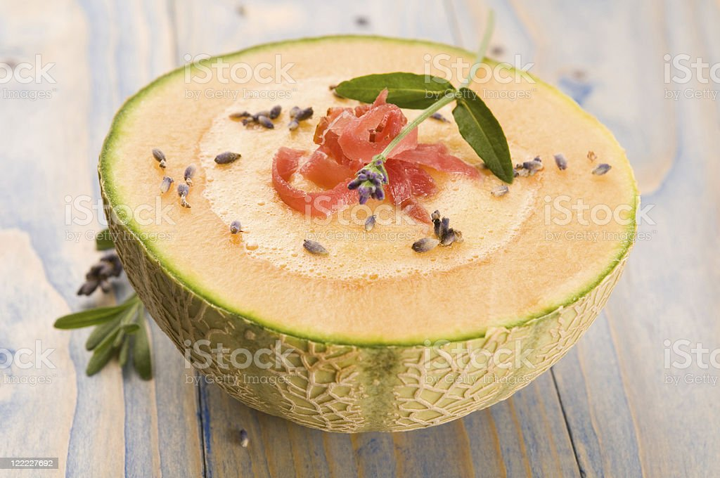 fresh melon soup with parma ham and lavender flower stock photo