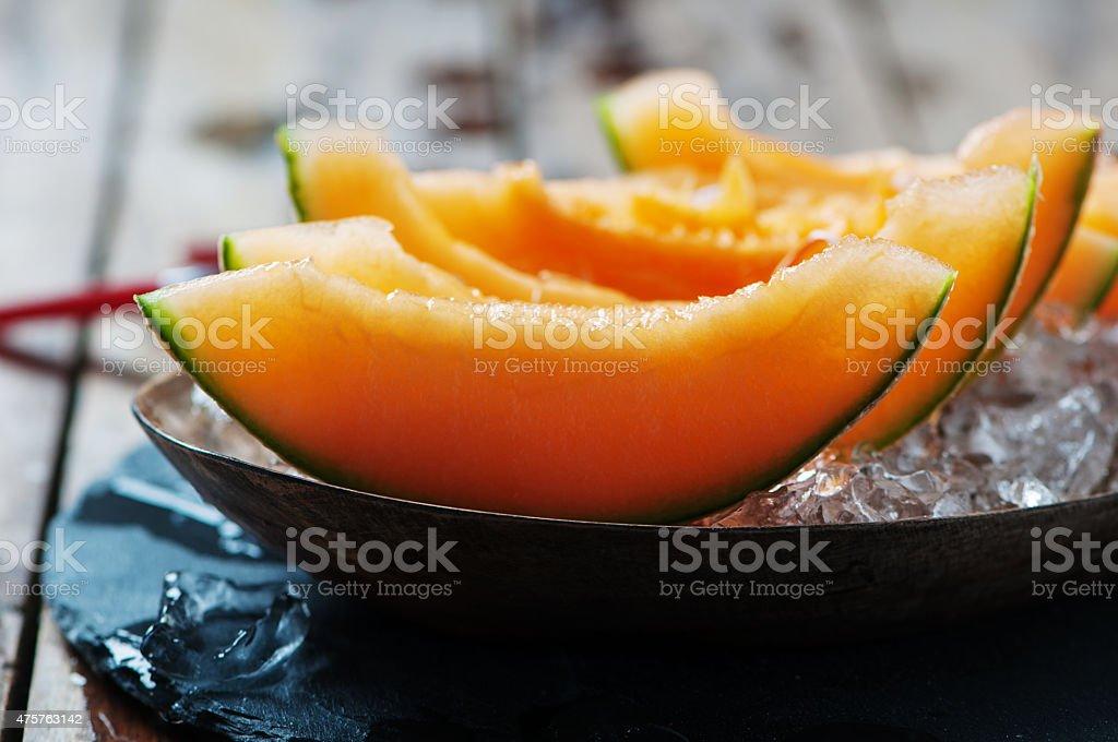 Fresh melon with ice stock photo