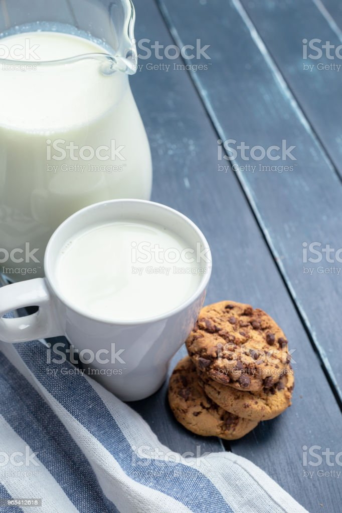 fresh milk in glass jug and glass on wooden background royalty-free stock photo