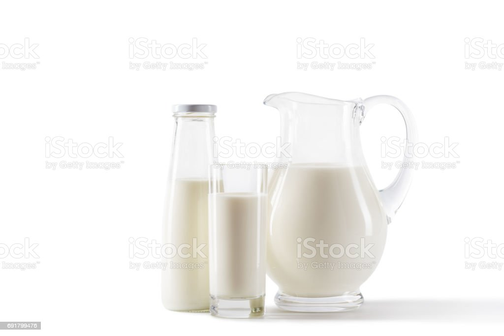 fresh milk in jug, bottle and glass isolated on white stock photo