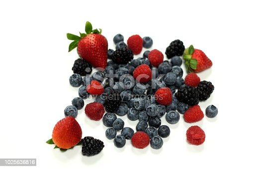 istock fresh mix berries on a white back ground 1025636816