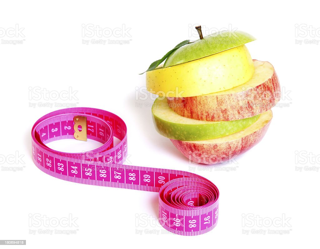 Fresh mixed apple with measuring tape stock photo