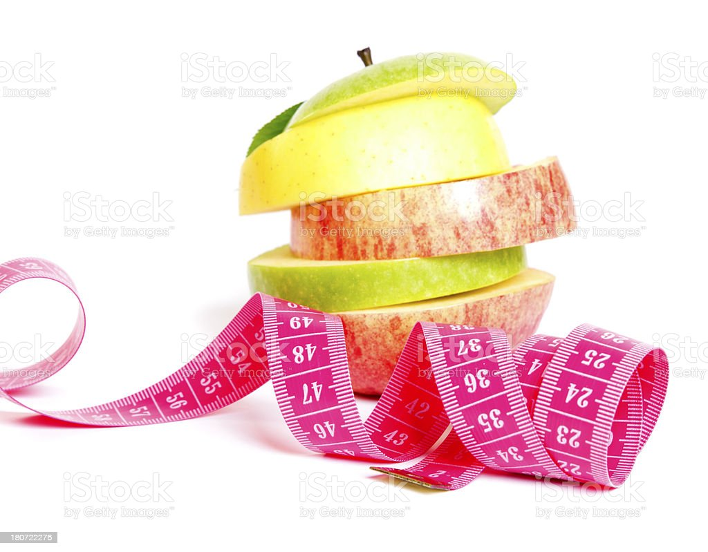 Fresh mixed apple with measuring tape royalty-free stock photo