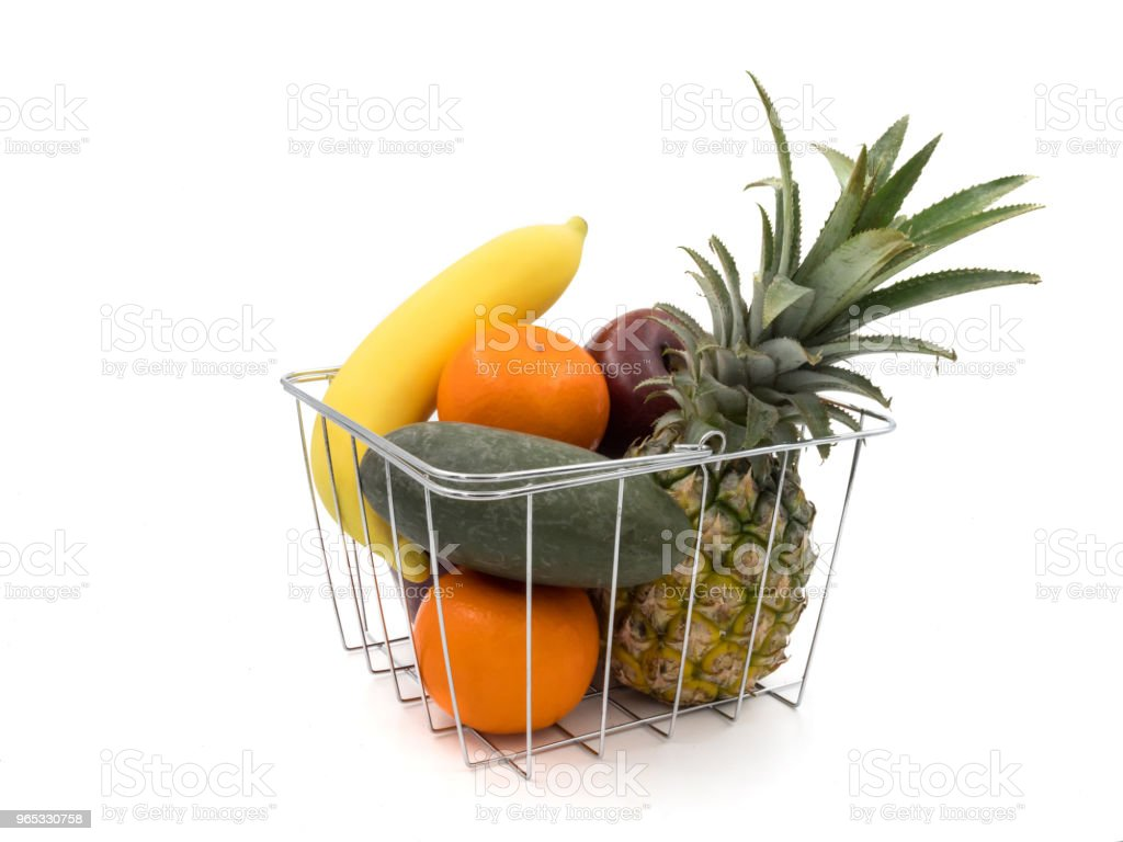 Fresh mixed fruits in basket on a white background royalty-free stock photo