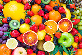 Fresh mixed fruits background.Organic fruits multicolore background.