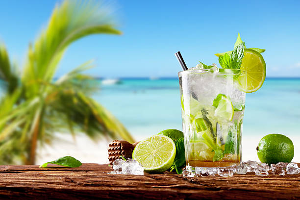 Fresh mojito cocktail on wood Mojito drink on wood with blur beach background mojito stock pictures, royalty-free photos & images