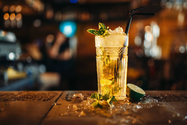 Fresh mojito in a glass and ice on bar counter stock photo