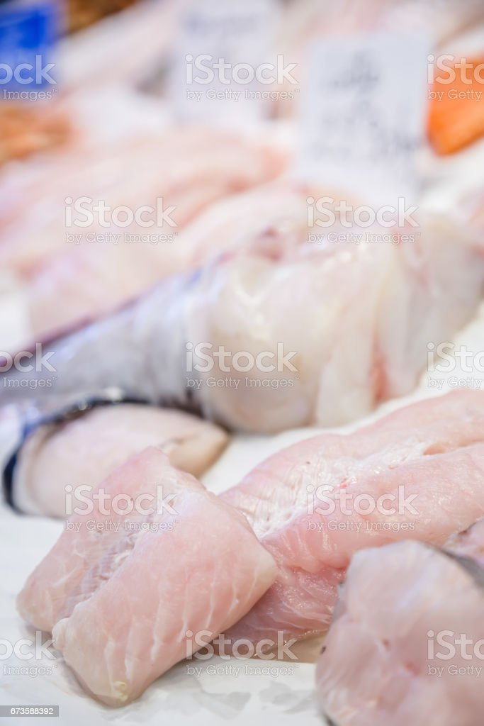 Fresh monkfish fillet on ice for sale at market stock photo