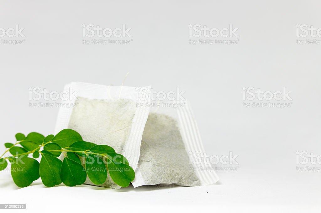 Fresh Moringa Leaves and Tea Bag stock photo
