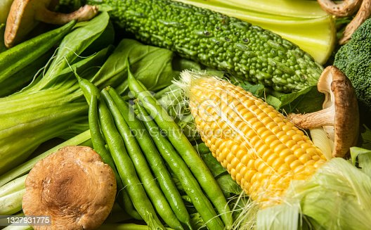 istock Fresh mostly green vegetables flat on board 1327931775