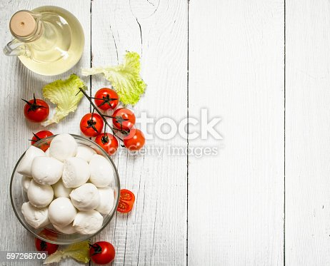 Fresh Mozzarella With Olive Oil Tomatoes And Herbs Stock Photo & More Pictures of Appetizer