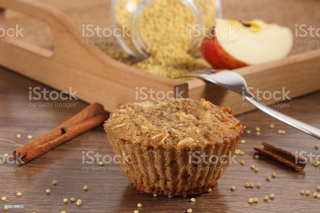 Fresh muffin with millet groats, cinnamon and apple stock photo