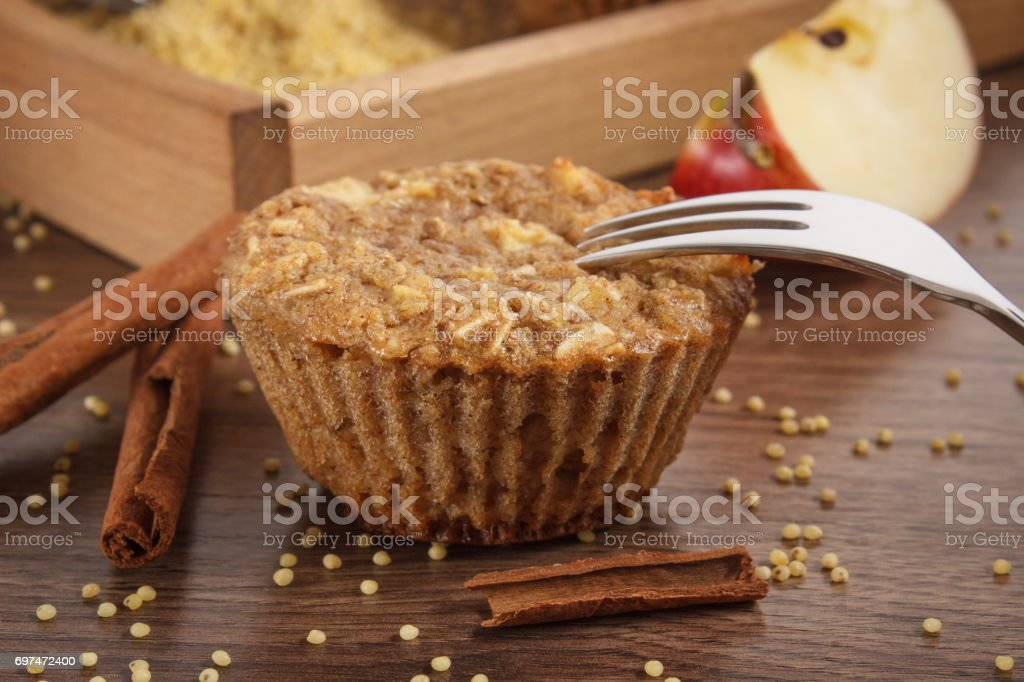 Fresh muffins with millet groats, cinnamon and apple baked with wholemeal flour, delicious healthy dessert stock photo