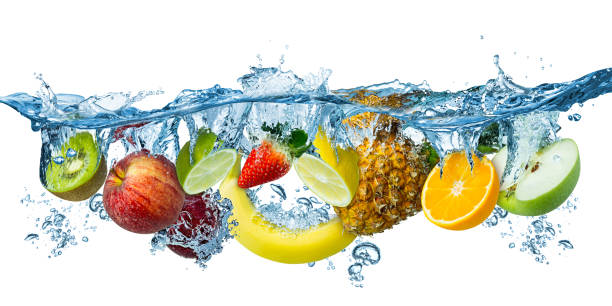 fresh multi fruits splashing into blue clear water splash healthy food diet freshness concept isolated white background fresh multi fruits splashing into blue clear water splash healthy food diet freshness concept isolated on white background fruit stock pictures, royalty-free photos & images