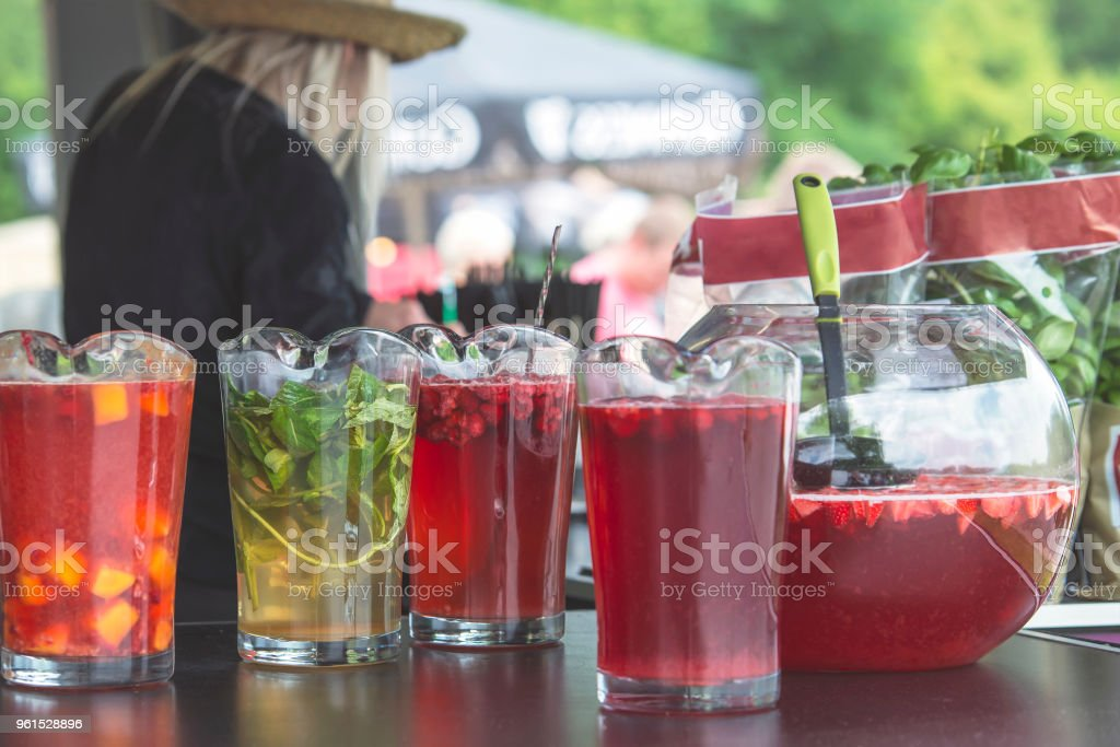 Fresh multi-colored ingredients for the production of berry smoothies in glass containers. stock photo