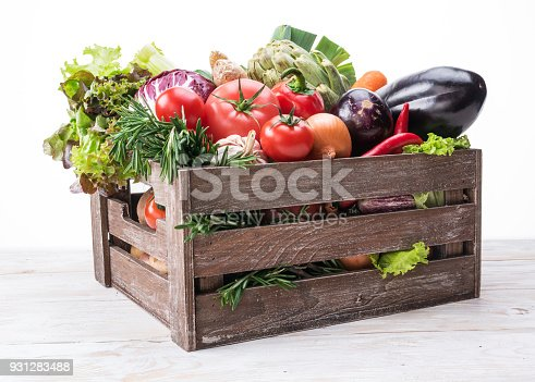 istock Fresh multi-colored vegetables in wooden crate. 931283488