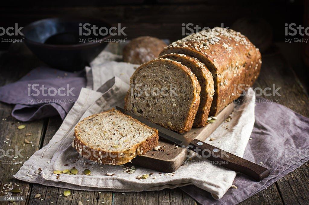 fresh  multigrain bread on rustic background stock photo