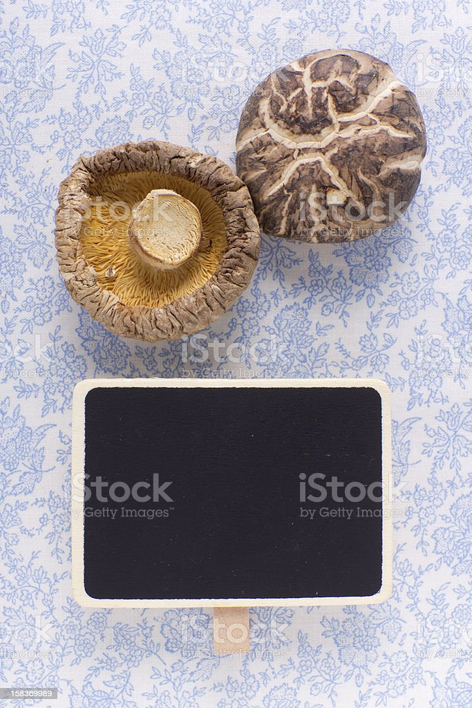 Fresh mushrooms and blank blackboard royalty-free stock photo