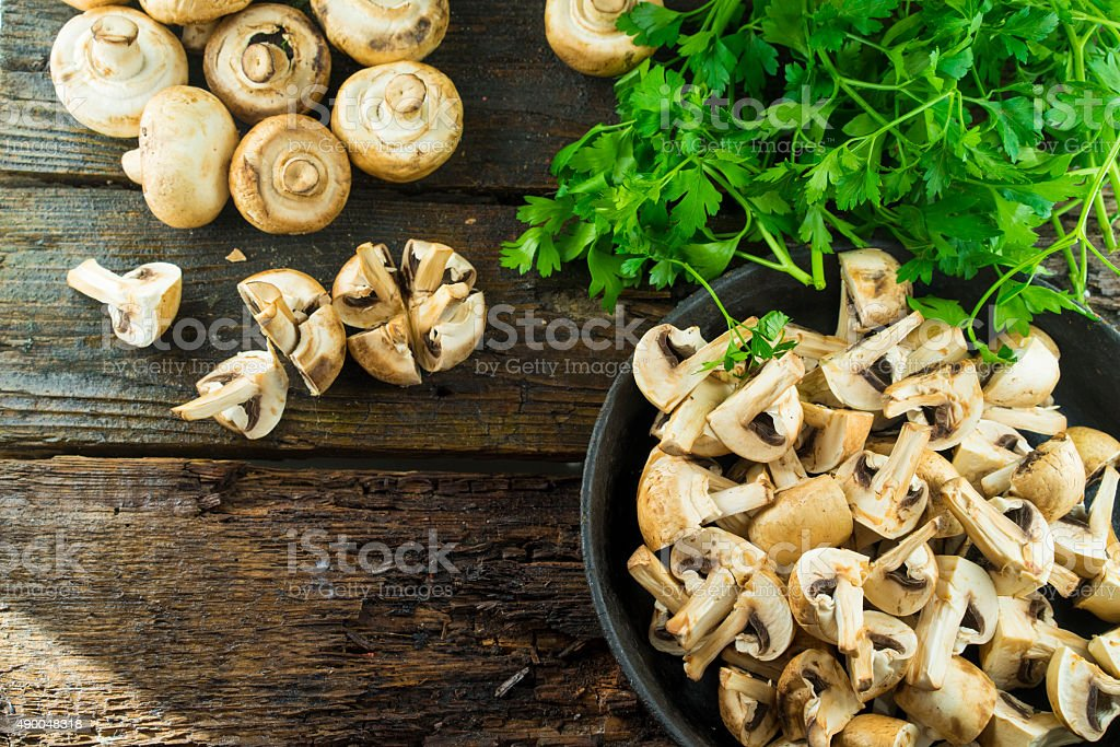 Fresh mushrooms in a pan stock photo