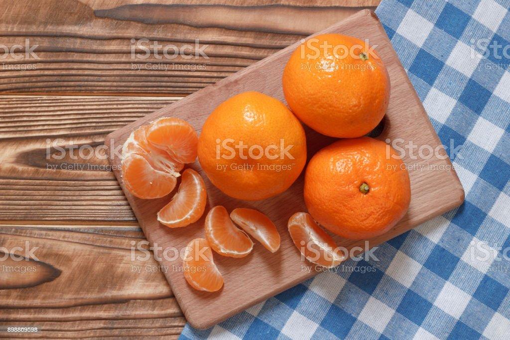 Fresh natural mandarins closeup on table stock photo