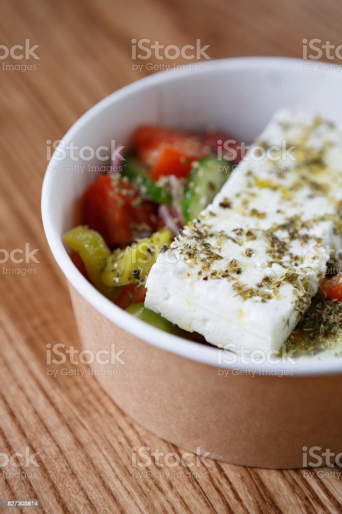 Fresh natural vegeterian Greek salad with olives & feta cheese stock photo