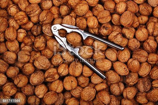 istock Fresh natural walnuts and nutcracker 641741544
