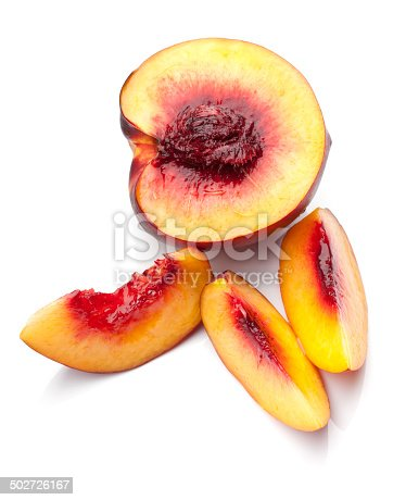 A fresh, juicy nectarine sliced in half and three slices.