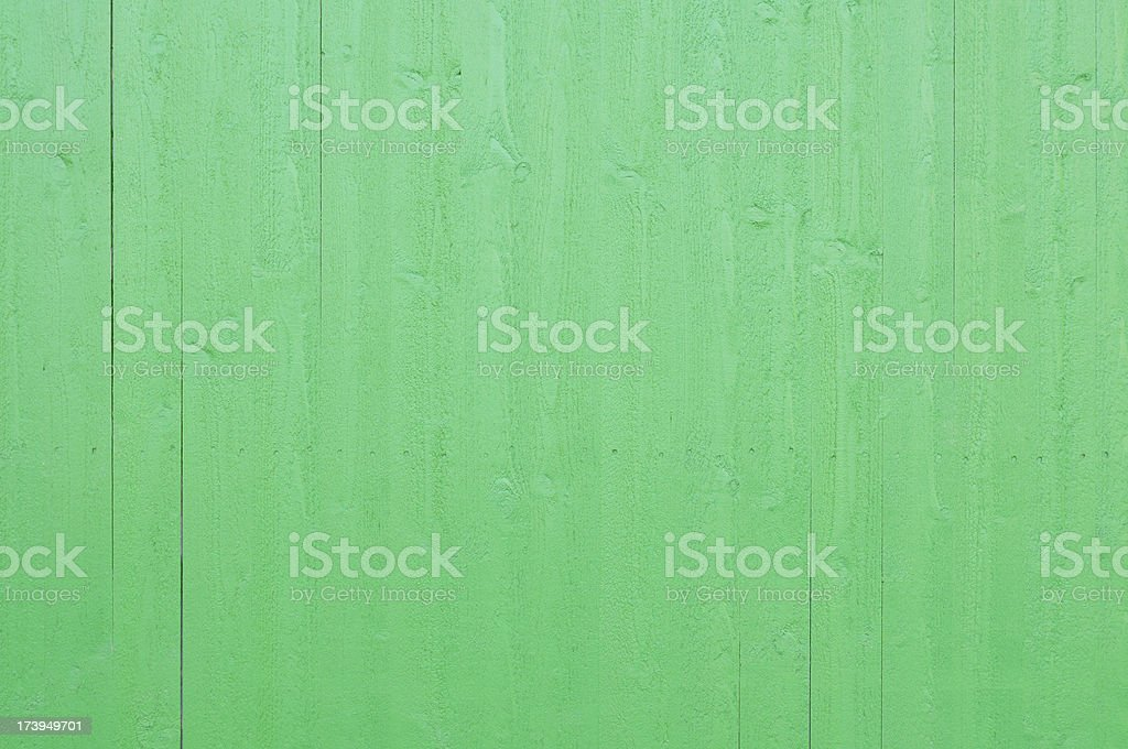Fresh newly painted green wooden plank wall royalty-free stock photo