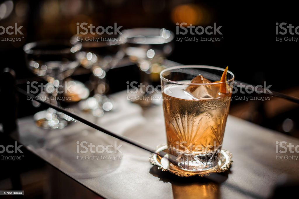 Fresh old fashioned summer cocktail with ice and orange peel royalty-free stock photo