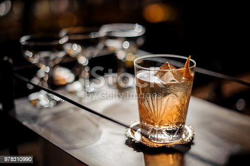 istock Fresh old fashioned summer cocktail with ice and orange peel 978310990