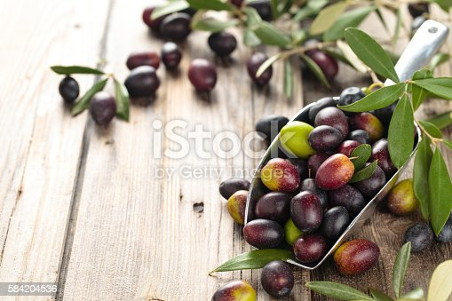 istock Fresh olives in scoop. 584204536