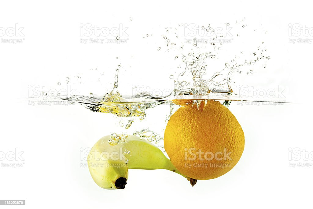 Fresh orange and banana water splash stock photo